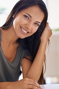 young woman with straight teeth smiling